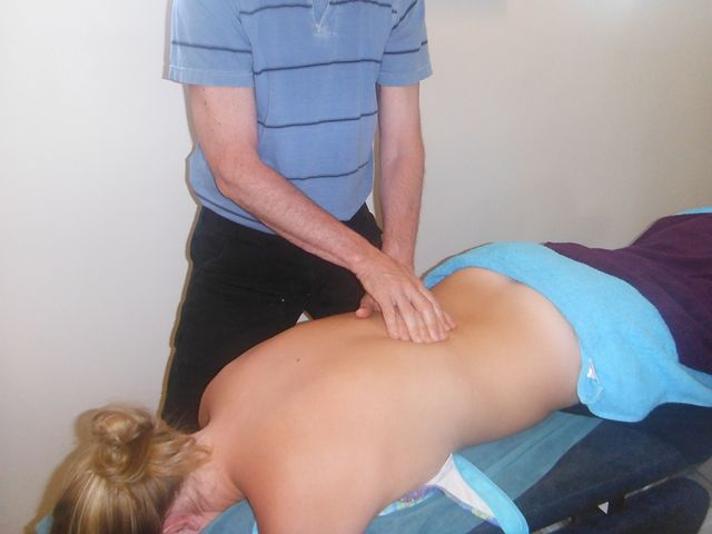 Woman receiving chiropractor Norwest service