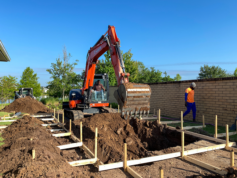 Reliable swimming pool builders in Gold Coast digging a hole