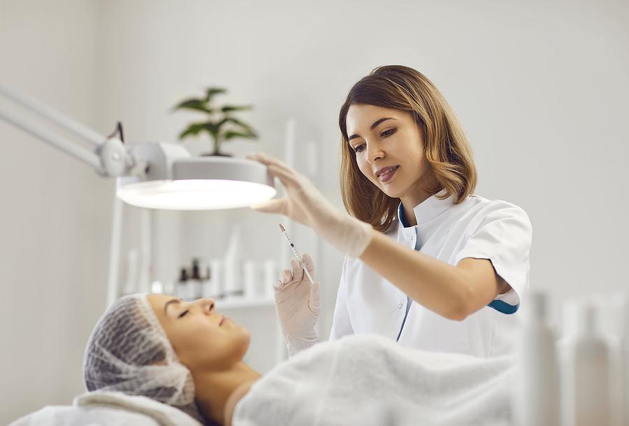 Woman getting a facial in a beauty salon in Sydney CBD