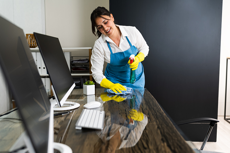 Office cleaning company Sydney professional cleaning an office table