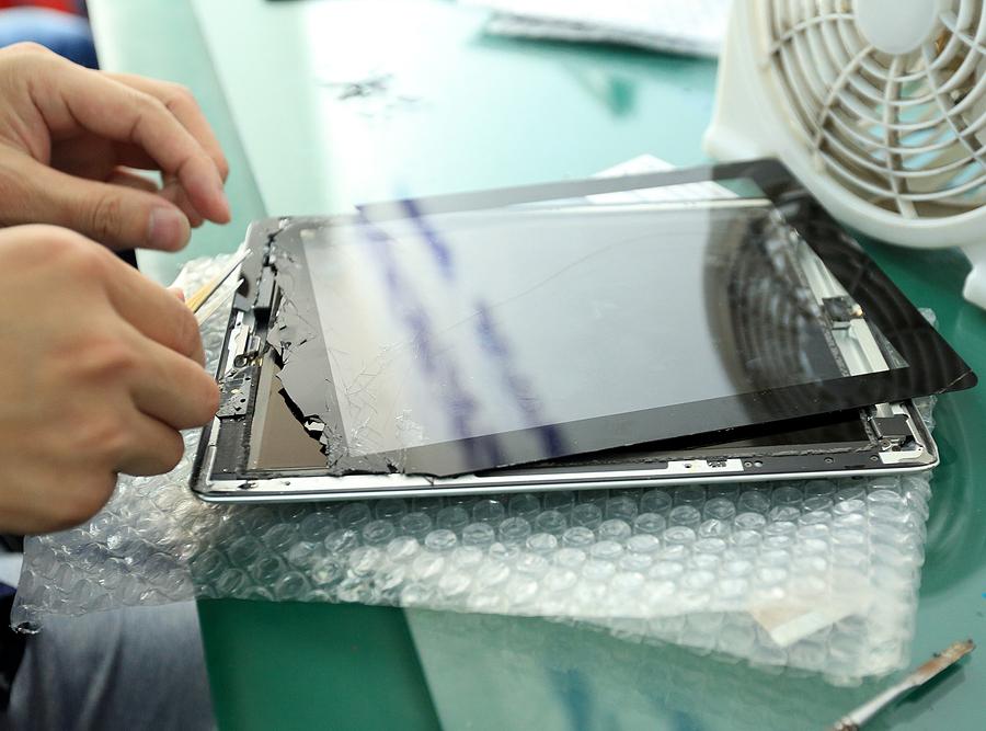 Technician servicing iPad repairs in Sydney